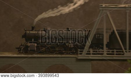 Side View Replica Of Steam Lokomotive. Retro Train With Steam On The Bridge.