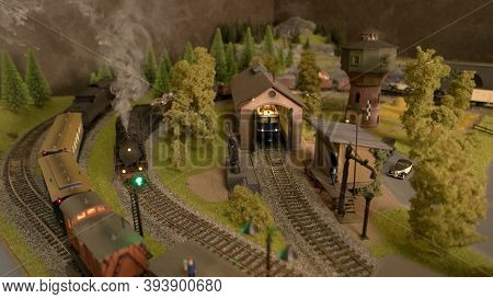 Retro Toy Lokomotives. Countryside Railway Station. Vintage Railway.