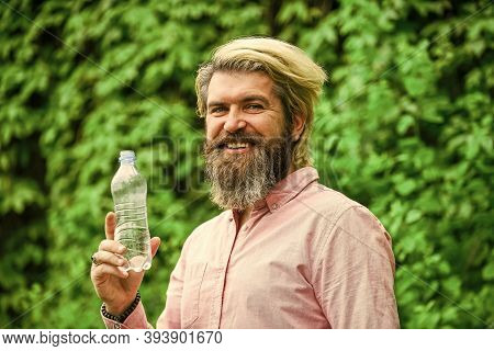 Water Balance. Man Bearded Tourist Drinking Water Plastic Bottle Nature Background. Summer Heat. Thi