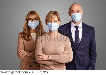 Group Of Business Persons With Face Masks Standing Side By Side