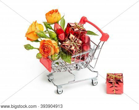 Gifts, Flowers, Christmas Toys In The Shopping Cart. Buyer's Basket. Full Shopping Cart.  The Concep