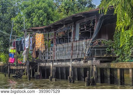 Bangkok, Thailand, 16,07,2019 - Wooden Houses Built In Chao Phraya River, Old Wooden Houses