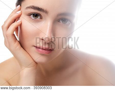 Close Up Portrait Of A Relaxed And Focused Pretty Young Woman With No Makeup And Glowing Fresh Skin