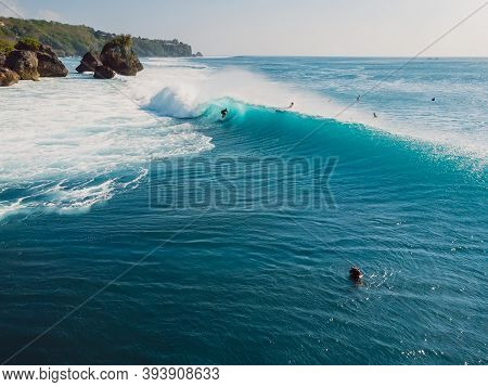 Aerial View With Surfing At Barrel Wave. Blue Perfect Waves And Surfers In Ocean