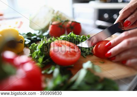 Close-up Of Woman Cutting Small Tomato With Knife. Process Of Preparing Quick Lunch. Fresh Mellow Ve