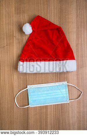 Santa Claus Hat And Face Mask Creative Minimal Concept Flat Lay Of Corona Christmas During Coronavir