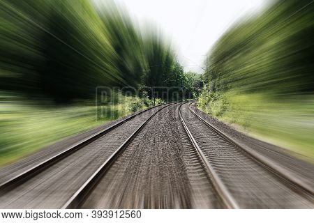 Double-track Railroad Railway Or Train Tracks With Speed Motion Blur - Fast Travel Concept Backgroun