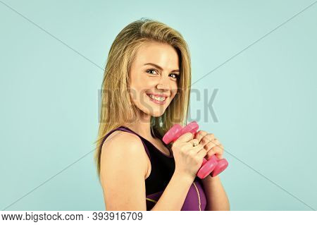 Always In Good Shape. Coach Dressed In Sport Clothes. Muscular Woman In Training Pumping Up Muscles