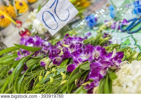 Thailand, Bangkok 18,07,2019 Pile Of Purple Orchid Flowers Stacked On At Flower Market In Thailand