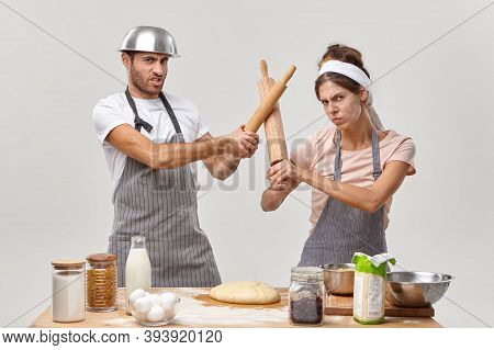 Photo Of Professional Cooks Have Battle At Kitchen, Participate In Culinary Contest, Fencing With Ro