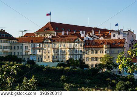Prague, Czech Republic - September 19, 2020. Panoramic View On Building In Uvoz Steet With Czech Fla