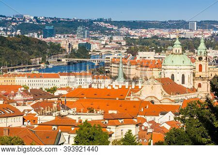 Prague, Czech Republic - September 19, 2020. Orange Roofs Of Old Town In Contrast With Blue River Vl