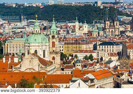 Prague, Czech Republic - September 19, 2020. Famous Towers Above Roofs