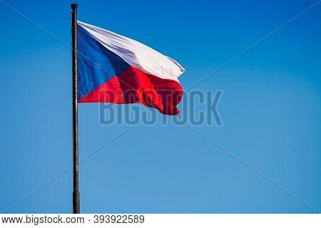 Prague, Czech Republic - September 19, 2020. Flag Of Czechia Flying In The Wind On The Blue Sky