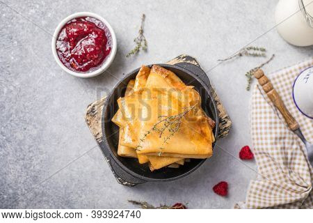 Homemade Recipe Of Thin Crepes (blini) For Breakfast Or Dessert. Crepes With Berry In A Cast Iron Pa