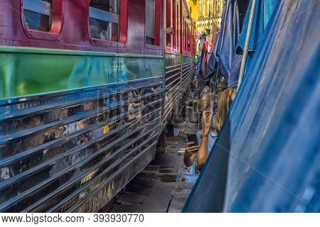 Samut Songkhram, Thailand - 07.07, 2019 : Tourists Take Photo At The Train Running Through The Most