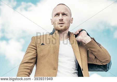 Close-up Of Handsome Young Man Wearing Suit Jacket, Sunglasses And Looking Away While Standing Again