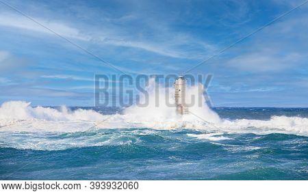 Waves Crashing Against The Mangiabarche Lighthouse; Scoglio Mangiabarche, Calsetta, South Sardinia