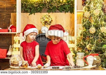 Cute Kids In Santa Hats Preparation Holiday Dinner For Family. Two Cute Boys With Santa Hat. Two Chl
