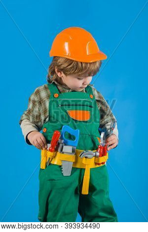 Tools For Building. Kid Repairman. Builder Boy In Helmet And Tools. Child Game. Little Boy In Builde
