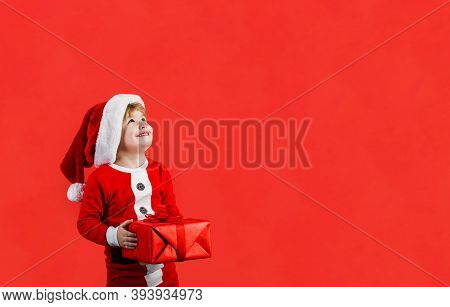 Christmas Boy. Little Kid Celebrating Christmas. Little Boy With Christmas Present. Happy Boy In San