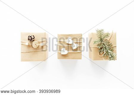 Christmas Handmade Gift Boxes Art Composition On White Surface. Gifts, Christmas Wooden Decorations,