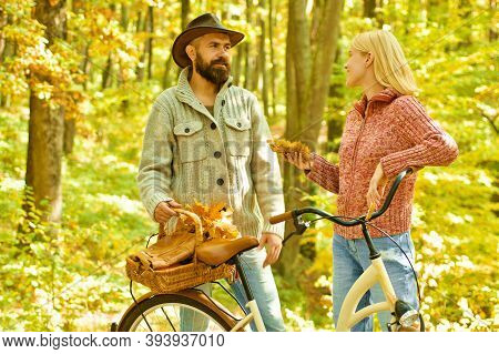 Autumn Date Hike In Forest. Couple In Love Ride Bicycle Together In Forest Park. Romantic Date With