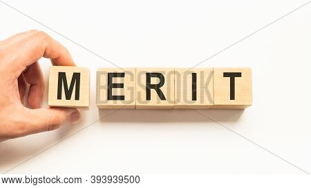 Word Merit. Wooden Small Cubes With Letters Isolated On White Background With Copy Space Available.b