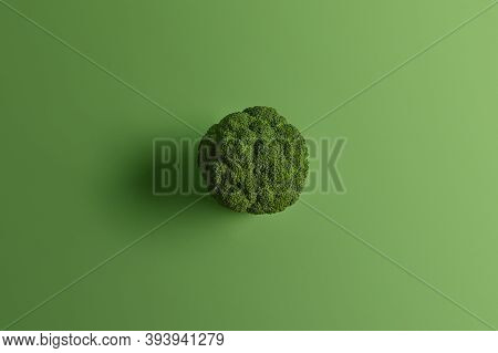 Nutritional Healthy Broccoli Photographed From Above On Green Background. Tasty Vegetable Can Be Eat