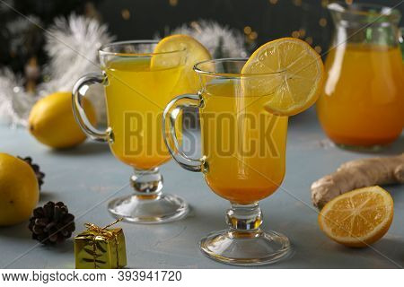 Homemade Invigorating Beverage With Lemon, Ginger, Honey And Turmeric On Dark Festive Background. Ho