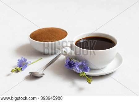 Chicory Drink, Chicory Powder And Blue Flowers On A White Background Closeup. Alternative To Coffee.