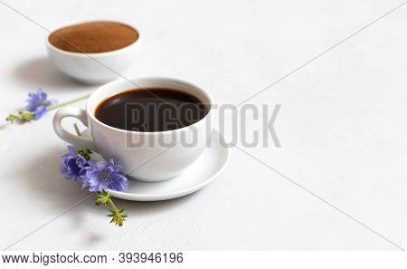 Cup With Chicory Drink And Chicory Powder On A White Background. Healthy Beverage. Coffee Substitute