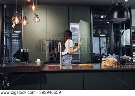 Preparing Fresh Food. Young Beautiful Brunette In Casual Clothes Indoors In Kitchen At Daytime.