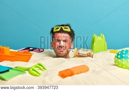 Sunburned Man With Red Face Skin, Frowns Face In Displeasure, Hates Heat, Drinks Cold Tea, Spends Fr