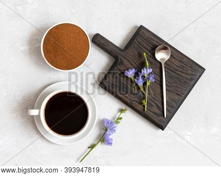 Chicory Beverage, Chicory Powder And Blue Flowers On A White Background. Useful Herbal Drink Without