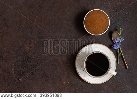 Cup With Chicory Coffee, Chicory Powder And Blue Flowers On A Brown Background. Space For Text. Top