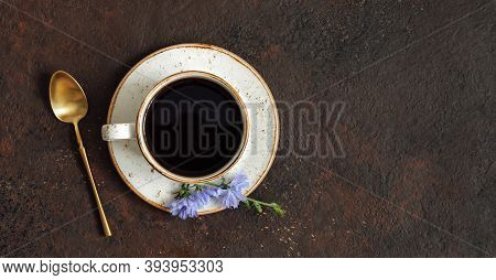 Chicory Drink, Golden Color Spoon And Chicory Flower On Dark Brown Background. Herbal Healthy Coffee