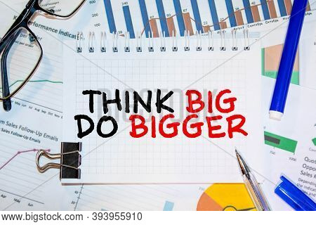 Writing Note Showing Think Big Do Bigger. Business Photo Showcasing Raise The Bar And Aim Far Higher