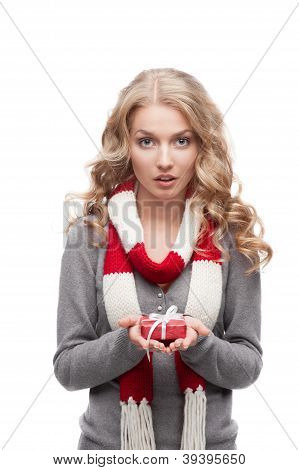 young surprised woman holding christmas gift