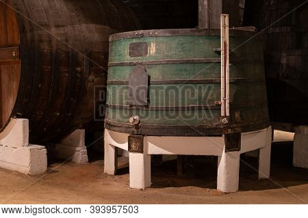 Old Porto Lodge With Rows Of Oak Wooden Casks For Slow Aging Of Fortified Ruby Or Tawny Porto Wine I