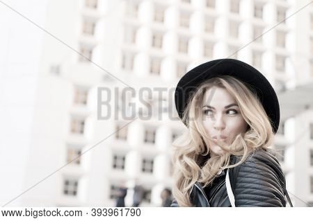 Girl Flirt With Sensual Face, Long Hair, Black Hat In La Defense Paris. Fashion Beauty, Look. Vacati