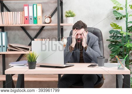 Unforgivable Mistake. Falling Stock Prices. Man Bearded Boss Sit Office With Laptop. Manager Solving