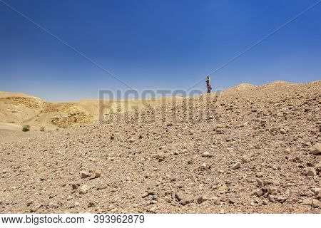 Desert Sand Stone Wasteland Wilderness Scenic View With Lonely Woman Person On Horizon Clear Weather