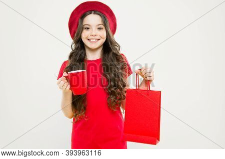 Shopping In France. Parisian Child On Yellow. Hairdresser Salon. Happy Girl With Long Curly Hair In