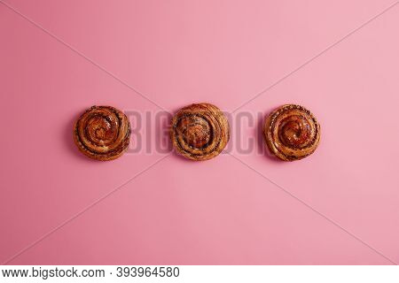 Three Tasty Soft Buns With Aromatic Smell, Bought In Bakers Shop, Isolated On Pink Background. Rolls