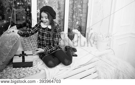 Magic Moment. Happy Winter Holidays. Small Girl Opening Gift. New Year. Santa Claus Gift. Little Gir
