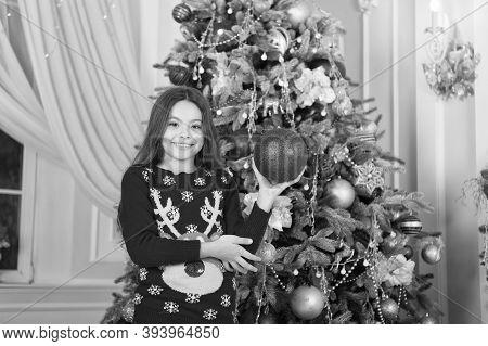 Have A Holly Jolly Xmas. Happy Child Hold Xmas Tree Ball. Little Girl Decorate Xmas Tree. Merry Xmas