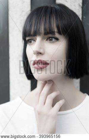 Girl Or Woman With Red Lips, Makeup Face, Brunette Hair Pose On Striped Background In Paris, France.