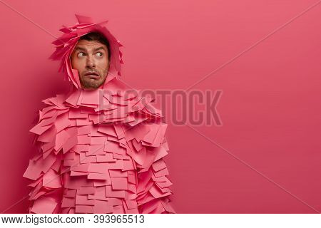 Puzzled Guy Concentrated Somewhere, Thinks How To Solve Situation, Has Indignant Face Expression, Pu