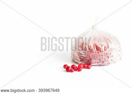 Frozen Red Cranberry Berries In A Plastic Bag Isolated On A White Background. Storage Of Frozen Food